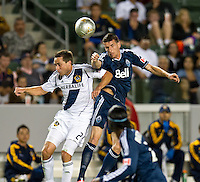 CARSON, CA - June 23, 2012: LA Galaxy defender Todd Dunivant (2) and Vancouver Whitecaps forward Sebastien Le Toux (7) during the LA Galaxy vs Vancouver Whitecaps FC match at the Home Depot Center in Carson, California. Final score LA Galaxy 3, Vancouver Whitecaps FC 0.