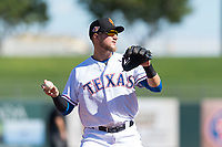 Surprise Saguaros third baseman Charles Leblanc (12), of the Texas Rangers organization, prepares to make a throw to first base during an Arizona Fall League game against the Peoria Javelinas at Surprise Stadium on October 17, 2018 in Surprise, Arizona. (Zachary Lucy/Four Seam Images)