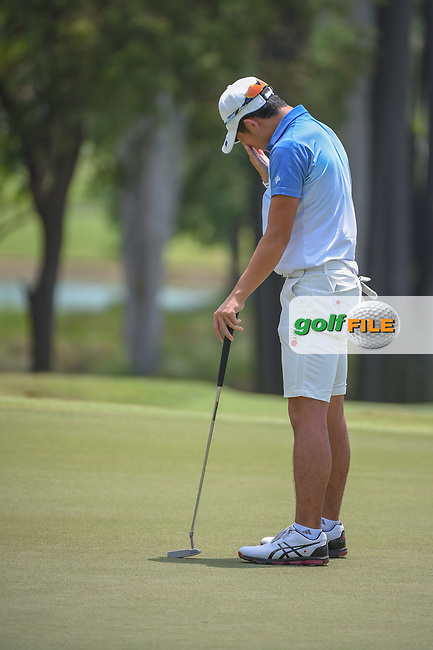 Keita NAKAJIMA (JPN) reacts to barely missing his putt on 9 during Rd 1 of the Asia-Pacific Amateur Championship, Sentosa Golf Club, Singapore. 10/4/2018.<br /> Picture: Golffile | Ken Murray<br /> <br /> <br /> All photo usage must carry mandatory copyright credit (© Golffile | Ken Murray)