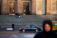 People walk in front of the main building of Moscow State University in Moscow, Russia.