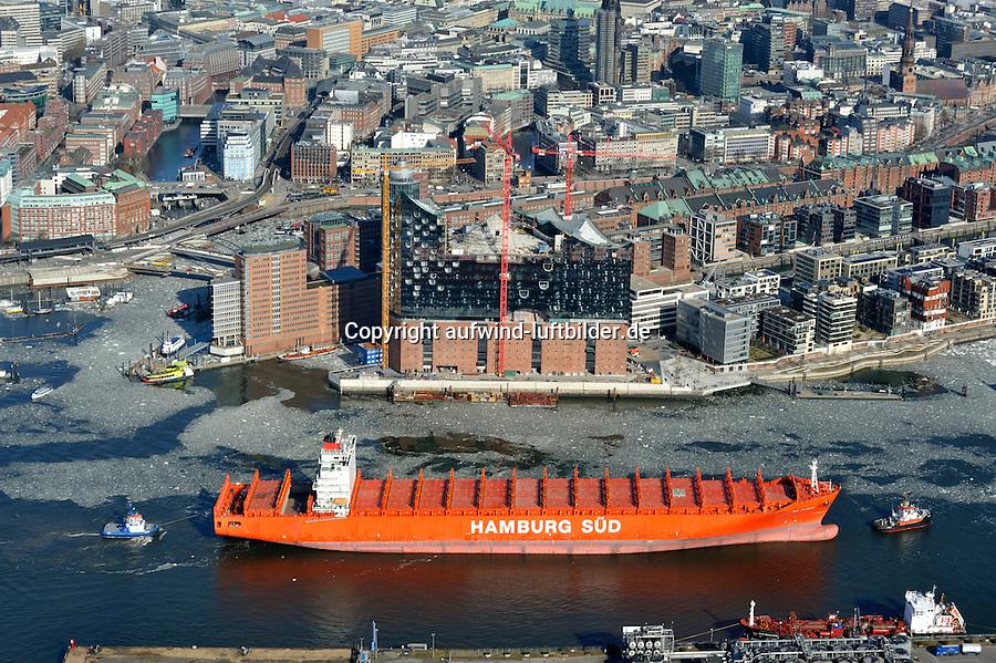 Schiff der Hamburg Sued und die Elbphilharmonie: EUROPA, DEUTSCHLAND, HAMBURG, (EUROPE, GERMANY), 20.02.2012: Die Rio Klasse ist eine sechs Containermotorschiffe der Postpanmax-Klasse umfassende Schiffsklasse der deutschen Reederei Hamburg Sued. Die Schiffe wurden in den Jahren 2008 und 2009 in Dienst gestellt und sind mit einer Gesamtlaenge von 286,45 Metern und einer Gesamtcontainerkapazitaet von 5905 TEU die zweitgroessten Containerschiffe der Reederei. Die Schiffe verkehren im Liniendienst zwischen Nordeuropa und der Ostkueste Suedamerikas. Ihr Heimathafen ist der Hamburger Hafen. Hinter dem Haus ist dieHamburger Elbphilharmonie und die Zentrale von Hamburg Sued zu sehen..