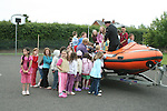 Stabannon Primary School pupils check out the boat when members of the Coastguard visited their school to give them a talk on water safety...Photo NEWSFILE/Jenny Matthews.(Photo credit should read Jenny Matthews/NEWSFILE)....This Picture has been sent you under the condtions enclosed by:.Newsfile Ltd..The Studio,.Millmount Abbey,.Drogheda,.Co Meath..Ireland..Tel: +353(0)41-9871240.Fax: +353(0)41-9871260.GSM: +353(0)86-2500958.email: pictures@newsfile.ie.www.newsfile.ie.FTP: 193.120.102.198.
