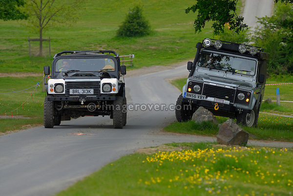 Land Rover based off-road racer passing a Land Rover Defender 130 Crew Cab at the ALRC National 2008. The Association of Land Rover Clubs (ALRC) National Rallye is the biggest annual motor sport oriented Land Rover event and was hosted 2008 by the Midland Rover Owners Club at Eastnor Castle in Herefordshire, UK, 22 - 27 May 2008. --- No releases available. Automotive trademarks are the property of the trademark holder, authorization may be needed for some uses.
