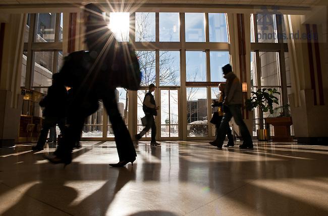 Students walk through the Mendoza College of Business atrium...Photo by Matt Cashore/University of Notre Dame