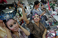 Transvestite performers prepare to go onto stage at the Tiffany's show in Pattaya late February 10, 2012. Originating as a one man show performed for friends on New Yearีs eve in 1974 in Pattaya, 150 km (90 miles) east of Bangkok Tiffany show became world famous transvestite cabaret with dozens of artists performing every night. Pattaya, a magnet for foreign tourists seeking sun, sea, watersports and racy nightlife, was a sleepy beach town until the 1970s and started to swell during the Vietnam War when U.S. troops, sailors and airmen flocked there for rest and relaxation.  Picture taken February 10, 2012. REUTERS/Damir Sagolj (THAILAND)