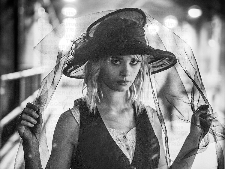 Blonde female model wearing a hat and veil