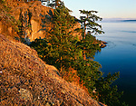 San Juan Islands, San Juan County, WA                    <br /> Evening light on rocky cliffs of Turn Point above the Haro Strait, Stuart Island