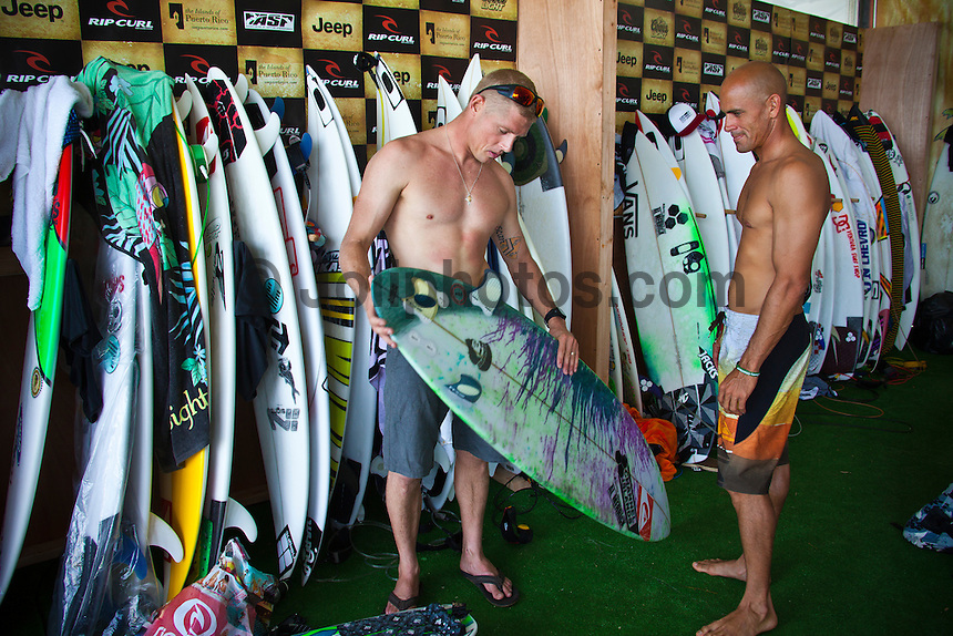 Mick Fanning (AUS) and Kelly Slater (USA) discuss Kelly's board.  MIDDLES, Puerto Rico (Saturday, October 30, 2010) -The Rip Curl Pro Search Puerto Rico was  called ON this morning with Round 1 commencing in three-to-four foot (1.5 metre) waves at the primary site of Middles.. .Event No. 9 of 10 on the 2010 ASP World Tour, the Rip Curl Pro Search Puerto Rico has captured the attention of the international sporting world as it will potentially host Kelly Slater (USA), 38, clinching an historic 10th ASP World Title.. Round 1 of the men was followed by Round 1 and Round 2 of the women..Photo: joliphotos.com