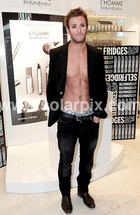 **ALL ROUND PICTURES FROM SOLARPIX.COM**.**NO UK NEWSPAPER PUBLICATION **UK MAGAZINE & SUPPLEMENT PUBLICATION ONLY** AND NO PUBLICATION IN FRANCE, SCANDINAVIA, AUSTRALIA AND GERMANY** .Stuart Pilkington from Big Brother 9 UK TV programme  launched the world's first YVES SAINT LAURENT ( Touche Eclat) for men at Selfridges high street stores in London this afternoon..The Yves Saint Laurent concealed is available in one shade that is made specifically for all men's skin types...JOB REF:7291-SFE       DATE:11_09_08 .**MUST CREDIT SOLARPIX.COM OR DOUBLE FEE WILL BE CHARGED* *UNDER NO CIRCUMSTANCES IS THIS IMAGE TO BE REPRODUCED FOR ANY ONLINE EDITION WITHOUT PRIOR PERMISSION*