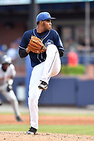 Asheville Tourists starting pitcher Antonio Santos (10) delivers a pitch during a game against the Charleston RiverDogs at McCormick Field on July 6, 2017 in Asheville, North Carolina. The Tourists defeated the RiverDogs 13-9. (Tony Farlow/Four Seam Images)