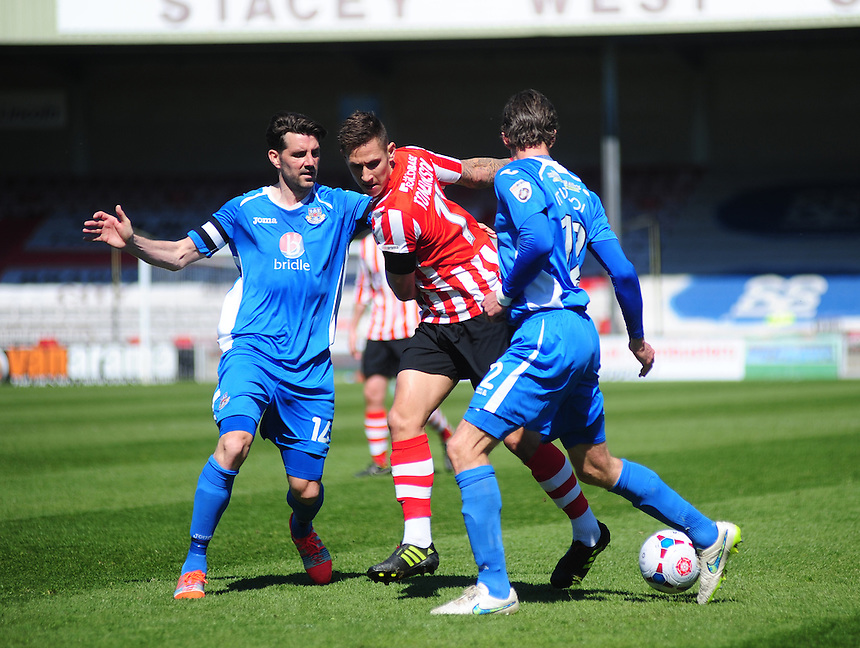 Eastleigh's Ben Strevens, left, and Eastleigh's Jack Midson, right look to close out Lincoln City's Ben Tomlinson<br /> <br /> Photo by Andrew Vaughan/CameraSport<br /> <br /> Football - English Football Vanarama Conference Premier League - Lincoln City v Eastleigh - Saturday 18th April 2015 - Sincil Bank - Lincoln<br /> <br /> &copy; CameraSport - 43 Linden Ave. Countesthorpe. Leicester. England. LE8 5PG - Tel: +44 (0) 116 277 4147 - admin@camerasport.com - www.camerasport.com