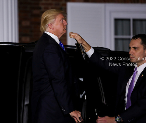 United States President-elect Donald leaves the clubhouse of Trump International Golf Club, after a day of meetings, November 19, 2016 in Bedminster Township, New Jersey. <br /> Credit: Aude Guerrucci / Pool via CNP