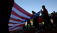 Children carry the colors of the United States on the field for pre-game ceremonies at the opening to the FIFA Under 20 World Cup Group C Match between the United States and Germany at the Mubarak Stadium on September 26, 2009 in Suez, Egypt. The US team lost to Germany 3-0.
