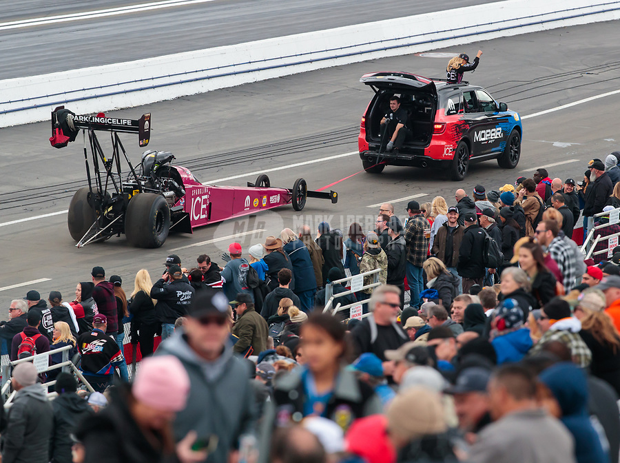 Feb 10, 2019; Pomona, CA, USA; NHRA top fuel driver Leah Pritchett waves to the fans during the Winternationals at Auto Club Raceway at Pomona. Mandatory Credit: Mark J. Rebilas-USA TODAY Sports