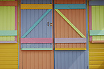 Close up of bright multi pastel coloured beach hut, Whitstable, Kent