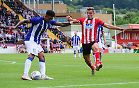 Sheffield Wednesday's Liam Palmer under pressure from Lincoln City's Harry Toffolo<br /> <br /> Photographer Chris Vaughan/CameraSport<br /> <br /> Football Pre-Season Friendly - Lincoln City v Sheffield Wednesday - Saturday July 13th 2019 - Sincil Bank - Lincoln<br /> <br /> World Copyright © 2019 CameraSport. All rights reserved. 43 Linden Ave. Countesthorpe. Leicester. England. LE8 5PG - Tel: +44 (0) 116 277 4147 - admin@camerasport.com - www.camerasport.com