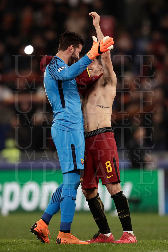 Football Soccer: UEFA Champions League  Round of 16 Second Leg, AS Roma vs FC Shakhtar Donetsk, Stadio Olimpico Rome, Italy, March 13, 2018. <br /> Roma's goalkeeper Alisson Becker (l) and Diego Perotti (r) celebrate after winning 1-0 the Uefa Champions League football soccer match between AS Roma and FC Shakhtar Donetsk, at at Rome's Olympic stadium, March 13, 2018.<br /> UPDATE IMAGES PRESS/Isabella Bonotto