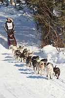 Musher Sven Haltman on Long Lake at the Re-Start of the 2011 Iditarod Sled Dog Race in Willow, Alaska.