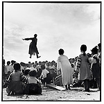 A woman of the Korean minority jumping on a seesaw during the annual sports contest of Shangzhi County; Hedong Commune , Heilongjiang Province, September 1, 1975