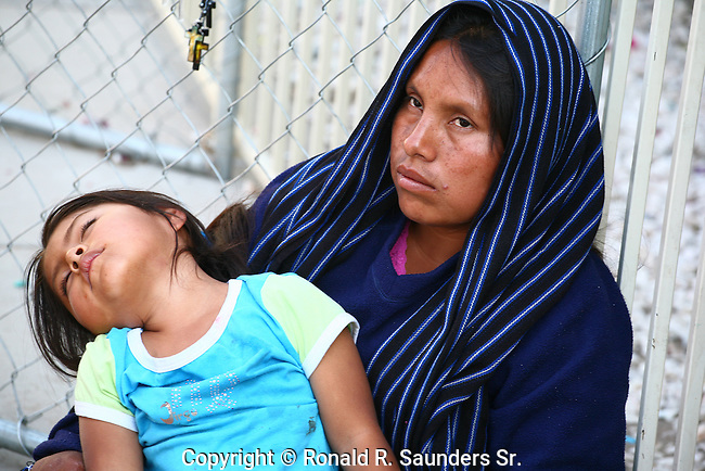 POOR MEXICAN MOTHER HOLDS HER SICK CHILD<br /> (12)