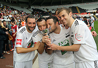 Pictured L-R: Dane Bowers, Kevin Cooper, Antony Costa and Dan Osborne kiss the winning cup after the game. Sunday, 01 June 2014<br /> Re: Celebrities v Celebrities football game organised by Sellebrity Scoccer, in aid of Swansea City Community Trust, at the Liberty Stadium, south Wales.