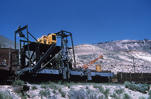 Side-view of the rail puller used when dismantling the Black Canyon lines in 1955.  Apparatus is built atop the chassis of spreader #OV.<br /> D&amp;RGW    1955
