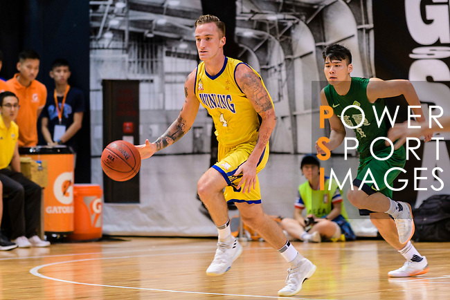 Bullen Christian Matthew #4 of Winling Basketball Club dribbles the ball up court against the Tycoon during the Hong Kong Basketball League playoff game between Winling and Tycoon at Queen Elizabeth Stadium on July 24, 2018 in Hong Kong. Photo by Marcio Rodrigo Machado / Power Sport Images