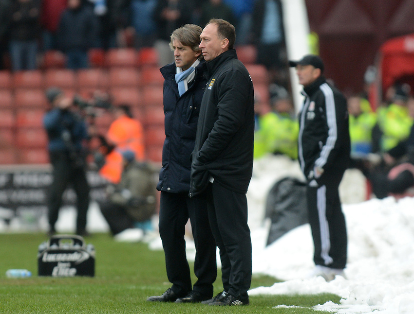 Manchester City's Manager Roberto Mancini and assistant David Platt chat during the game . - Credit - CameraSport - Ian Cook - ..Football - FA Challenge Cup Fourth Round - Stoke City v Manchester City - Saturday 26th January 2013 - Britannia Stadium - Stoke..