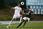 24 September 2013: North Carolina's Nick Williams (27) and William and Mary's Chris Perez (10). The University of North Carolina Tar Heels hosted the College of William and Mary Tribe at Fetzer Field in Chapel Hill, NC in a 2013 NCAA Division I Men's Soccer match. William and Mary won the game 1-0.