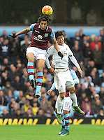 Rudy Gestede of Aston Villa beats Ki Sung-Yueng of Swansea City in the air during the Barclays Premier League match between Aston Villa v Swansea City played at the Villa Park Stadium, Birmingham on October 24th 2015