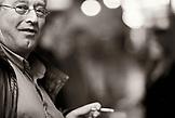 ENGLAND, London, portrait of a man sitting in a bar smoking (B&W)