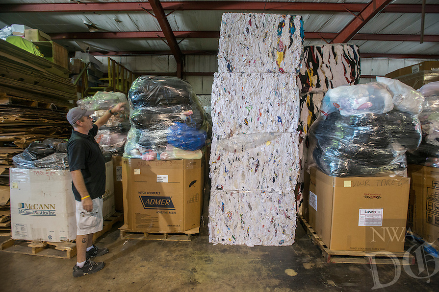 NWA Democrat-Gazette/ANTHONY REYES • @NWATONYR<br /> Vance Brock, owner of Northwest Rags Inc., shows some of the storage area Wednesday, Sept. 23, 2015 for products ready to be sorted or shipped out at Northwest Rags, Inc. in Springdale. The company ships used clothing all over the world, and has a line of industrial rags, Ozark Recycled Wiping Rags.