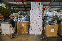 NWA Democrat-Gazette/ANTHONY REYES &bull; @NWATONYR<br /> Vance Brock, owner of Northwest Rags Inc., shows some of the storage area Wednesday, Sept. 23, 2015 for products ready to be sorted or shipped out at Northwest Rags, Inc. in Springdale. The company ships used clothing all over the world, and has a line of industrial rags, Ozark Recycled Wiping Rags.