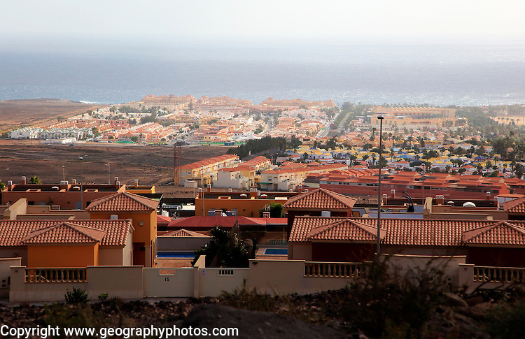 View over rooftops of villa housing in the Castillo development, Caleta de Fuste,  Fuerteventura, Canary Islands, Spain