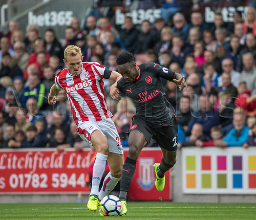 19th August 2017, bet365 Stadium, Stoke-on-Trent, England; EPL Premier League football, Stoke City versus Arsenal; Danny Welbeck of Arsenal is tackled by Darren Fletcher of Stoke City