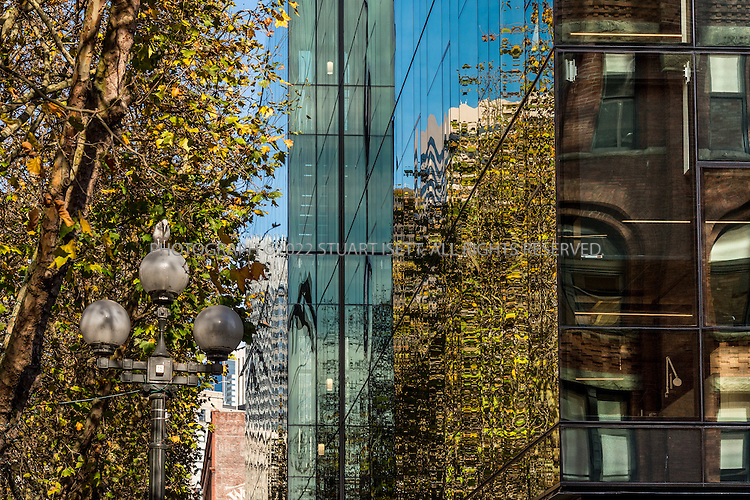 11/4/2016-- Seattle, WA, USA<br /> <br /> Weyerhaeuser&rsquo;s new Seattle headquarters in Pioneer Square, designed by architect Bill LaPatra, a partner at Mithun Architects, a firm well-known for its emphasis on sustainability.<br /> <br /> Here: Front of building looking north..<br /> <br /> The building is unusual, because it is almost self-effacing, with the front door opening onto a park-courtyard area, with the building almost hidden behind a line of mature trees. Despite its quiet appearance, this is headquarters for Weyerhaeuser, a major corporate employer.<br /> <br /> Photograph by Stuart Isett. &copy;2016 Stuart Isett. All rights reserved.
