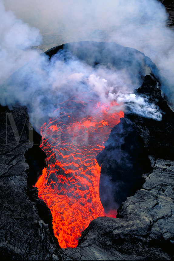 Kilauea Volcano - lava exploding from splatter cone inside of Pu'u' o'o vent. Hawaii, Volcanoes National Park.