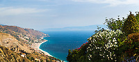 Panoramic photo of Letojanni Beach and Mazzeo Beach and the Ionian Sea (part of the Mediterranean Sea) seen from Taormina, East Coast of Sicily, Italy, Europe. This is a panoramic photo of Letojanni Beach and Mazzeo Beach and the Ionian Sea (part of the Mediterranean Sea) seen from Taormina on East Coast of Sicily, Italy, Europe.