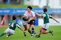 Yuki Sue of Japan takes on the Portugal defence. FISU World University Championship Rugby Sevens Women's 3rd/4th Play-off between Portugal and Japan on July 9, 2016 at the Swansea University International Sports Village in Swansea, Wales. Photo by: Patrick Khachfe / Onside Images
