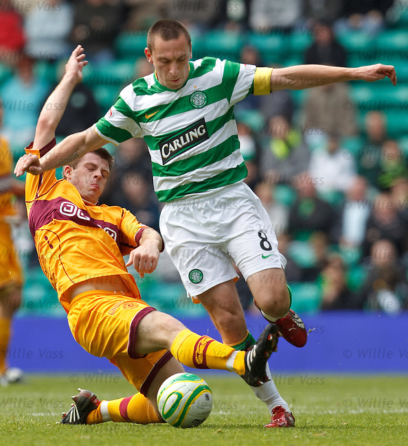 Steven Jennings tackles Celtic captain Scott Brown