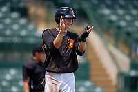 GCL Orioles Gunnar Henderson (9) claps after scoring the game tying run in the top of the seventh inning during a Gulf Coast League game against the GCL Braves on August 5, 2019 at Ed Smith Stadium in Sarasota, Florida.  GCL Orioles defeated the GCL Braves 4-3 in the second game of a doubleheader.  (Mike Janes/Four Seam Images)