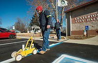 NWA Democrat-Gazette/BEN GOFF @NWABENGOFF<br /> Seth Hughes (left) with Centerton Public Works and Everett Wood, Centerton streets supervisor, paint lines Tuesday, Jan. 8, 2019, on a repaved section of parking lot in front of Centerton City Hall. The project repaired a pothole that was collecting water, according to Wood, and extended the paving a short distance into the adjacent gravel parking lot.