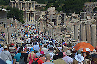 Michael McCollum.6/18/11.Large crowd of tourists heading for the Celsus library in Ephesus , turkey.