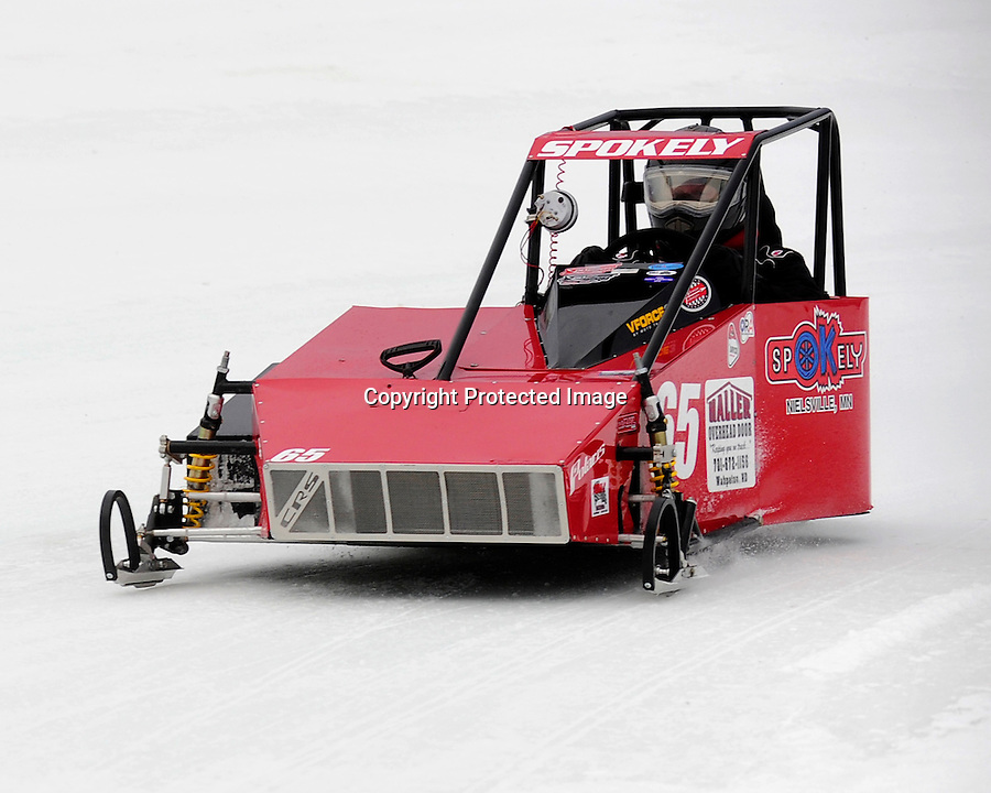 Trever Spokely of East Grand Forks, MN, races in the Outlaw 600 class during the AMSOIL World Championship Snowmobile Derby in Eagle River, WI, Jan. 19, 2014.