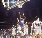 29 MAR 1982:  Patrick Ewing (33) of Georgetown shoots a jump shot over Sam Perkins (41) and Jimmy Black (21) during the Men's Final Four Championship held in New Orleans, LA at the Louisiana Superdome.  North Carolina defeated Georgetown 63-62 for the national title.  Photo Copyright Rich Clarkson