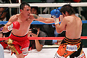 (L to R)  Hugo Cazares (Mex), Tomonobu Shimizu (JPN), AUGUST 31, 2011 - Boxing : Hugo Cazares of Mexico in action against Tomonobu Shimizu of japan during the ..WBA Super fly weight title bout at Nippon Budokan, Tokyo, Japan. Tomonobu Shimizu of Japan won the fight on points after twelve rounds. (Photo by Yusuke Nakanishi/AFLO SPORT) [1090]