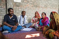 Technoserve's Manager of Market Linkage, Rajiv Shinde, interacts with vegetable farmers during a Producer Group meeting in Machahi village, Muzaffarpur, Bihar, India on October 26th, 2016. Non-profit organisation Technoserve works with women vegetable farmers in Muzaffarpur, providing technical support in forward linkage, streamlining their business models and linking them directly to an international market through Electronic Trading Platforms. Photograph by Suzanne Lee for Technoserve