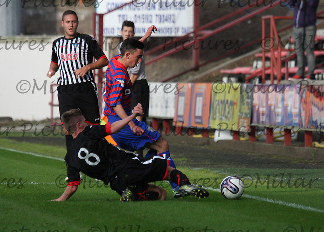 Anton Brady being tackled by Lewis Spence in the Dunfermline Athletic v St Mirren Scottish Professional Football League Under 20 match played at East End Park, Dunfermline on 6.8.13.