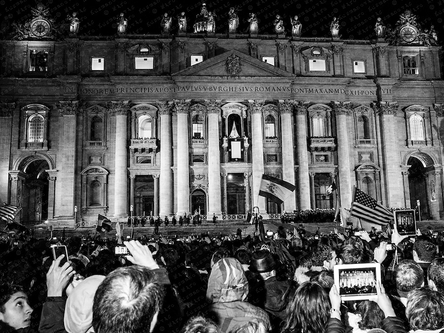 Faithful react after smoke rise from a chimney on top of the Sistine Chapel during voting for the election of a new pope at the Vatican.