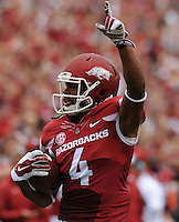 NWA Media/ANDY SHUPE - Arkansas receiver Keon Hatcher (4) celebrates as he carries the ball through the Nicholls defense on his way to the end zone on the first play of the game during the first quarter Saturday, Sept. 6, 2014, at Razorback Stadium in Fayetteville